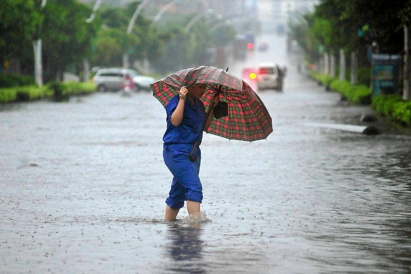 China renews blue alert for heavy rain