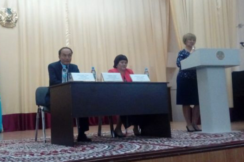 Representatives of presidential candidate Amangeldy Taspikhov meet with voters