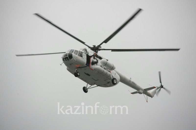 Второй вертолет поднят в воздух для тушения пожара на складе в Алматы