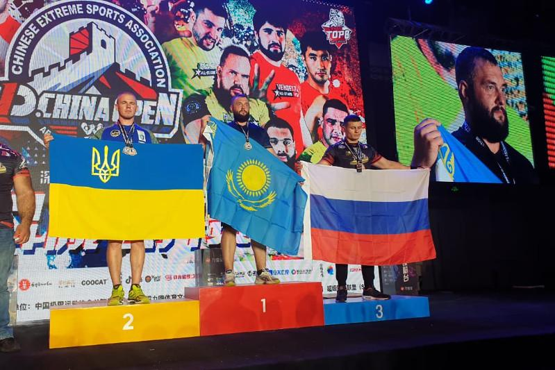 Arm wrestler Ilya Ilyin wins intl tournament in China