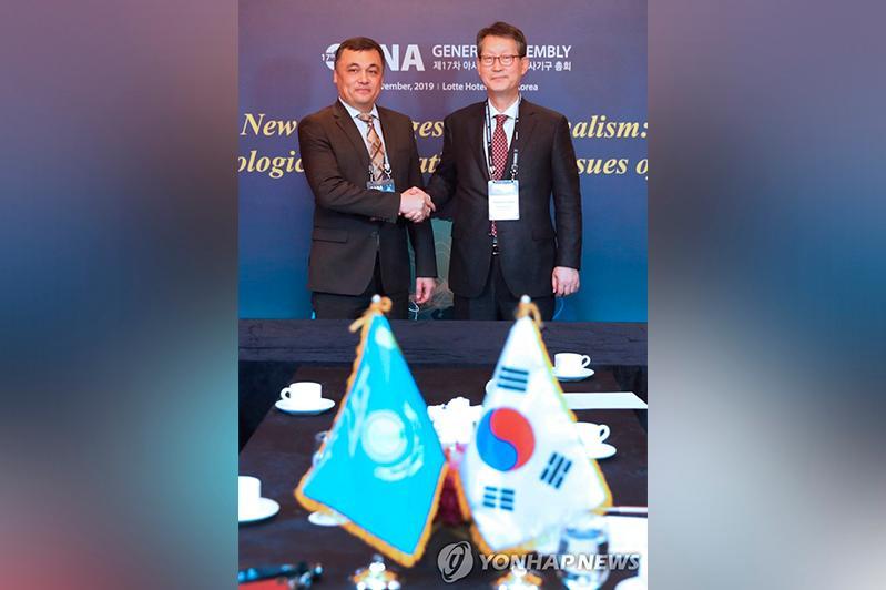 哈通社与韩联社签署合作备忘录