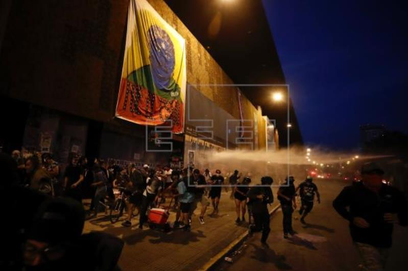 Chileans to vote on new constitution after weeks of unrest