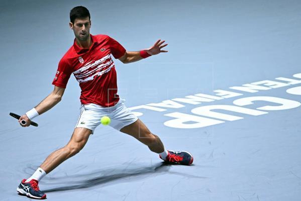 Djokovic shines as Serbia wins Davis Cup Finals opener