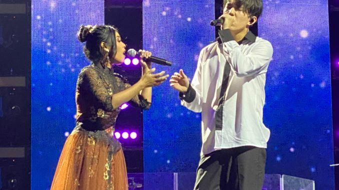 Dimash Kudaibergen and his Indonesian fan Rimar sing a duet at concert in St.Petersburg