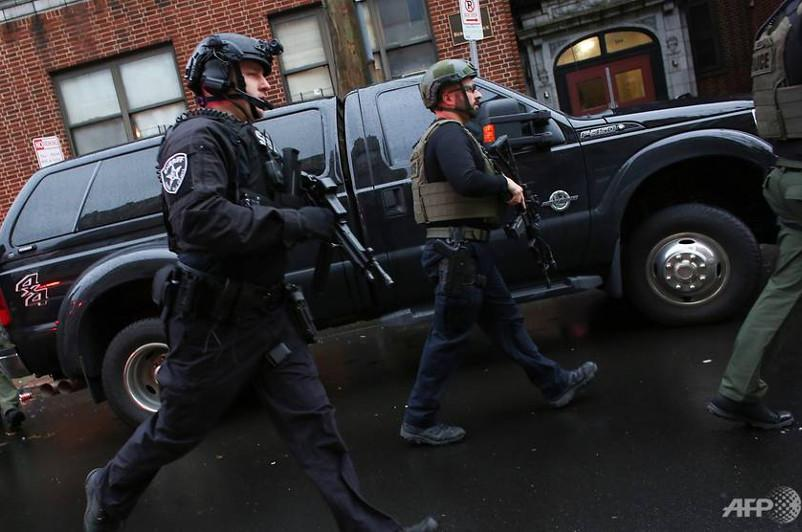 At least six dead, including two suspected gunmen, in Jersey City shooting