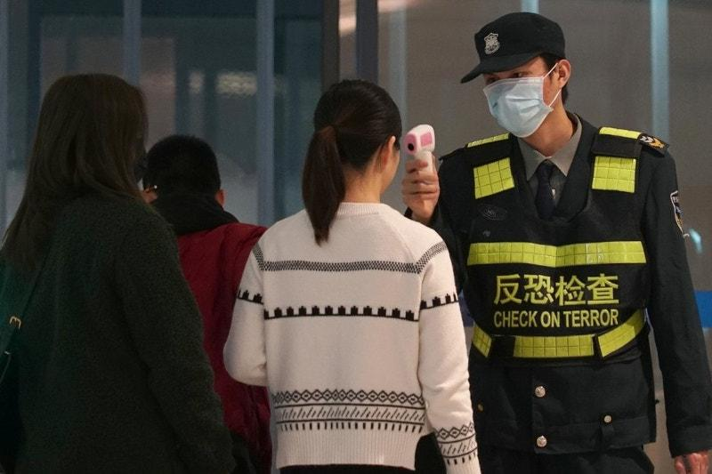 Japan confirms 2ndnew virus case, braces for Chinese tourist influx