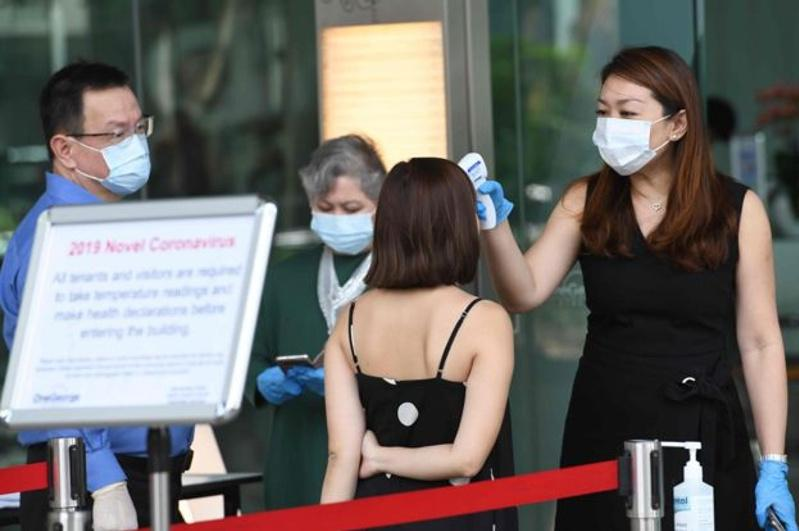 Коронавирус: Сингапур банкі 300 адамды эвакуациялады
