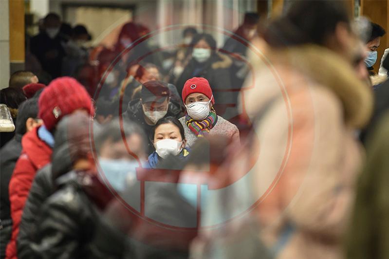 新冠肺炎19:中国湖北省一日内新增确诊病例1.4万余人
