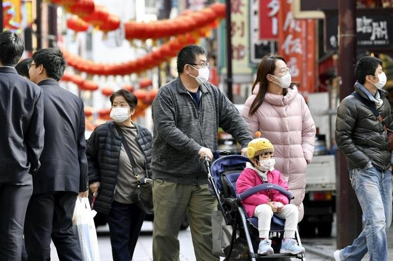 Japan confirms 1st coronavirus death as more infections reported