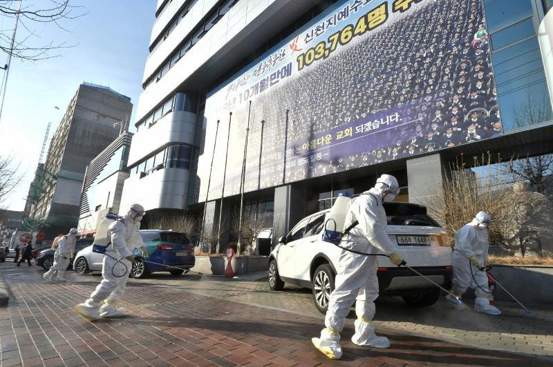 S. Korea reports 1st death from virus, cases soar to 104