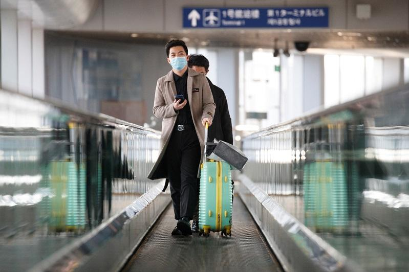 China suspends entry by foreign nationals