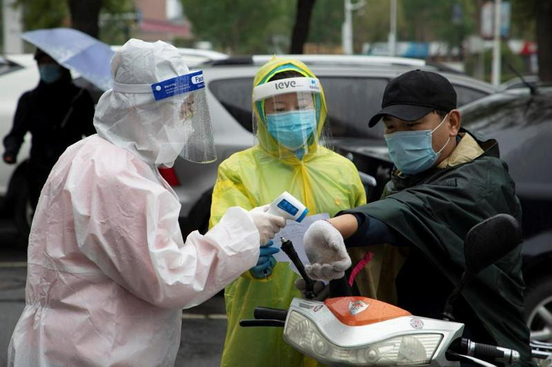 Beijing reports no new virus cases for 1st time in about 4 weeks