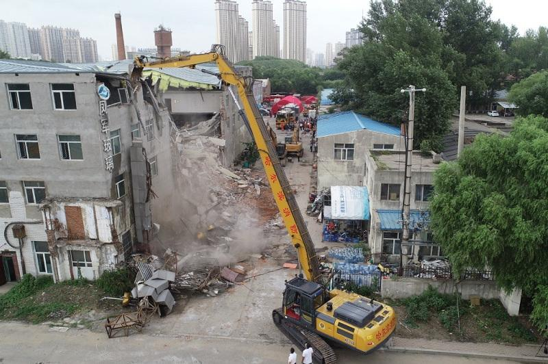 Four killed, five still trapped in collapsed building in Harbin