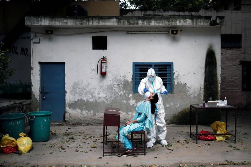 印度新冠肺炎日增确诊病例超过6万例