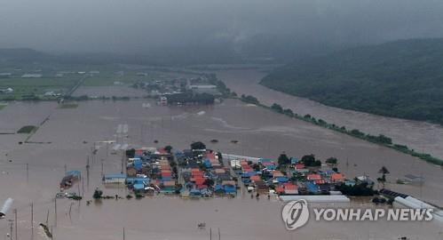 Moon declares 7 flood-battered parts of S. Korea as special disaster zones