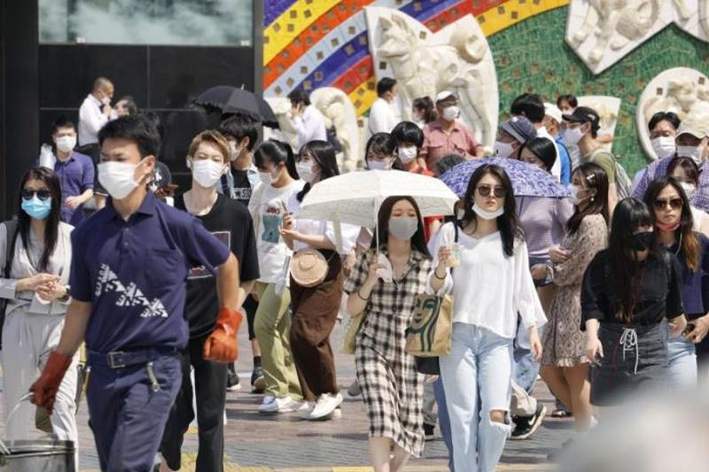 Japan to keep limiting people allowed at events to 5,000