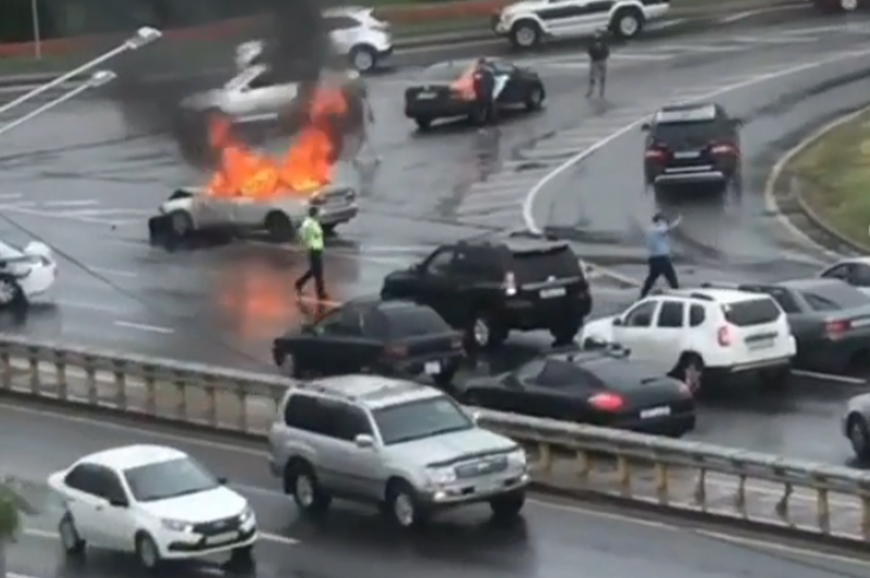 Car on fire crashes into police car in Almaty