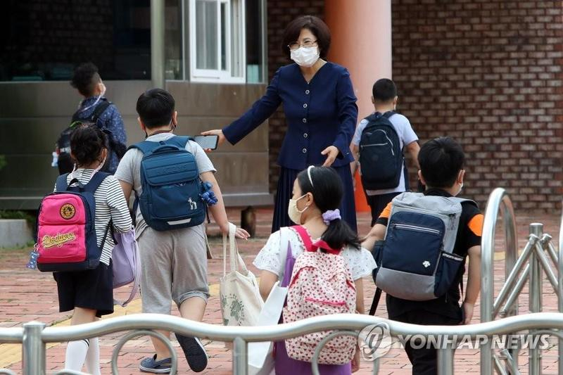 Schools in greater Seoul area to reopen next week