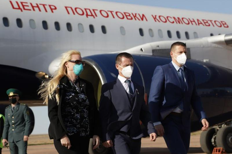 Crew members of ISS expedition 64 arrive at Baikonur Cosmodrome
