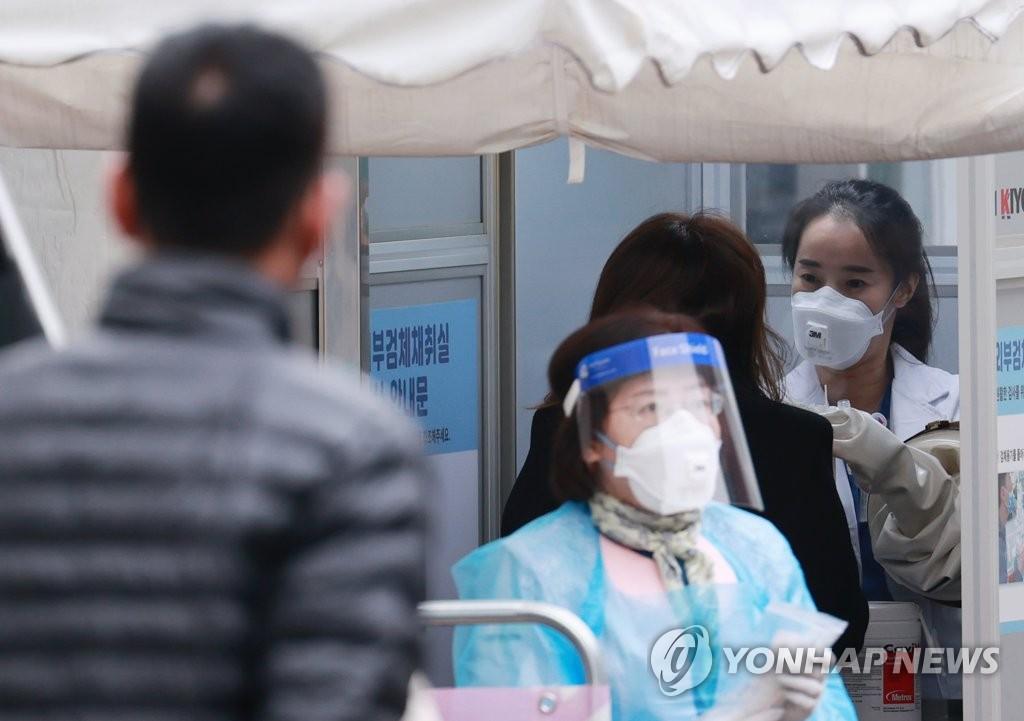 韩政府初步判断境内疫情现第三波流行