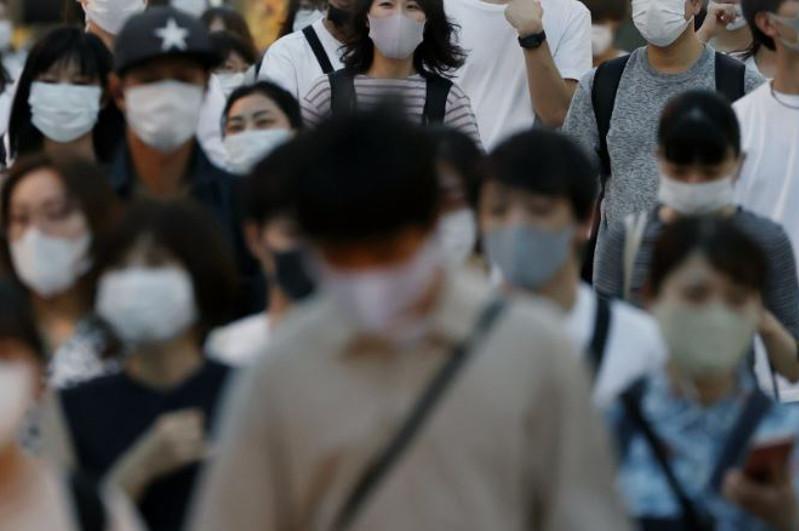 Japan expands virus emergency beyond Tokyo as cases top 300,000