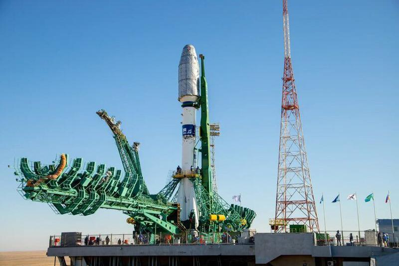 Soyuz-2.1a carrier rocket on launch pad at Baikonur Cosmodrome with 38 satellites