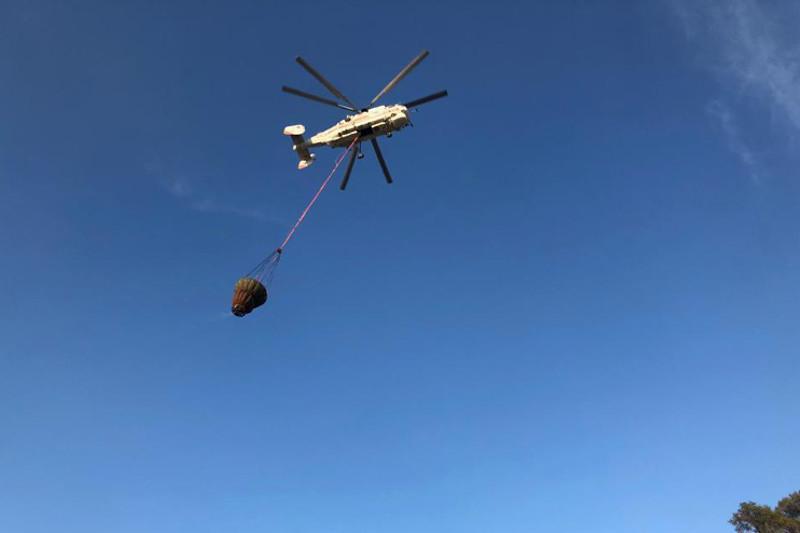 Задействован вертолёт МИ-8: пожарные ещё тушат лесной пожар близ Костаная