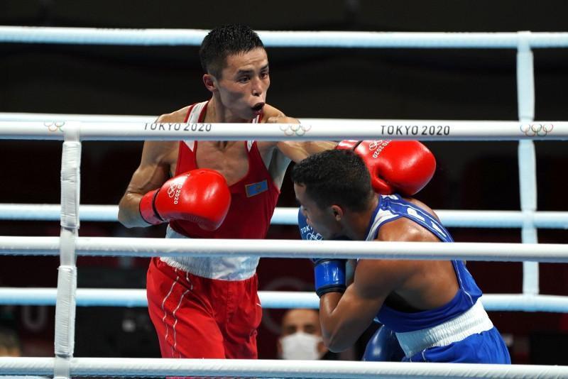 Kazakh Bibossinov boxes his way through at Tokyo Olympics