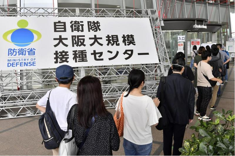 Japan to lower minimum age to 16 at state-run vaccination sites