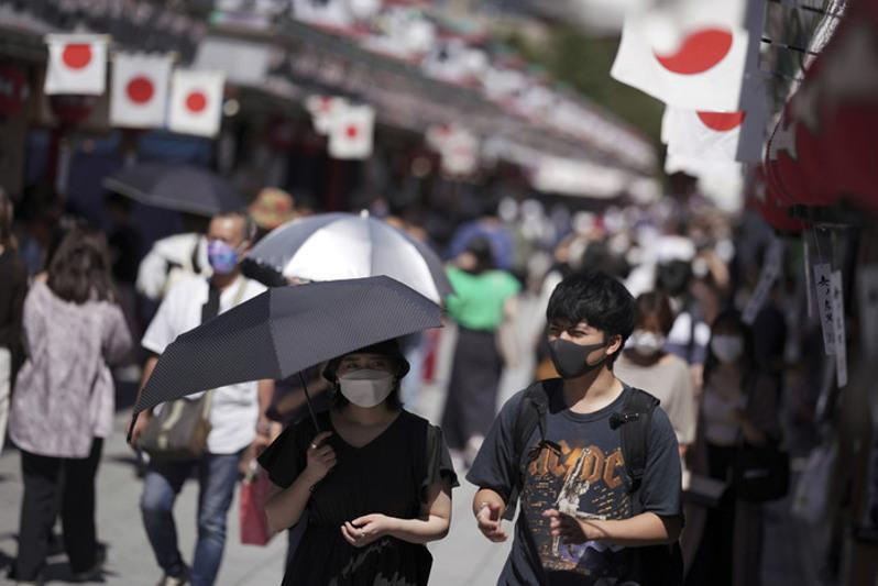 Suga says Japan will end COVID-19 state of emergency