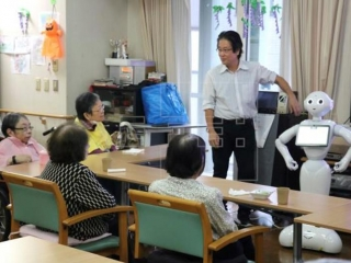 Japan tests robots as caregivers for the elderly