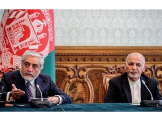 Afghan president and rival strike power-sharing deal after months of feuding