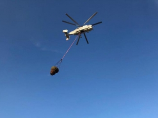 Helicopter extinguishes landfill fire in Almaty region