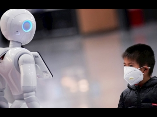 China Focus: AI robots tackling COVID-19 pandemic meet global consumers