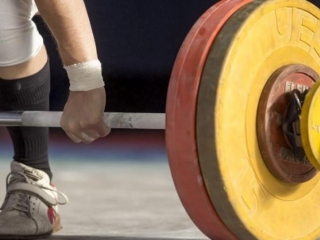 Kazakh girl scoops 3rd gold at World Weightlifting Championships